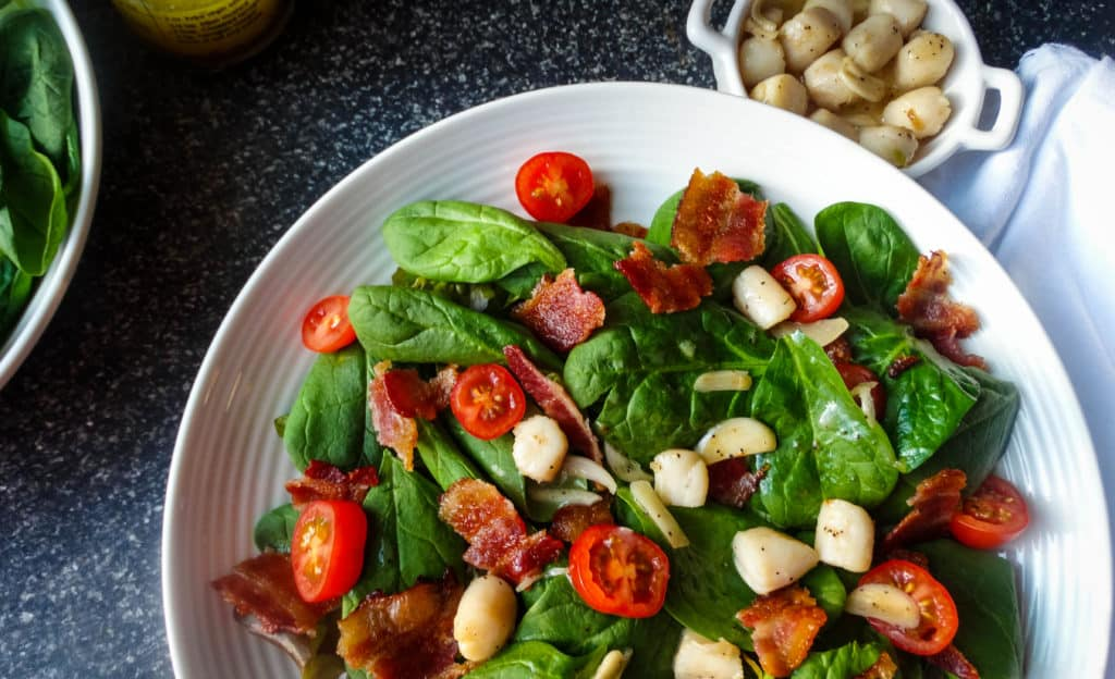 scallop bacon salad with spinach, tomatoes, and garlic butter. a simple and quick family-friendly weeknight dinner recipe
