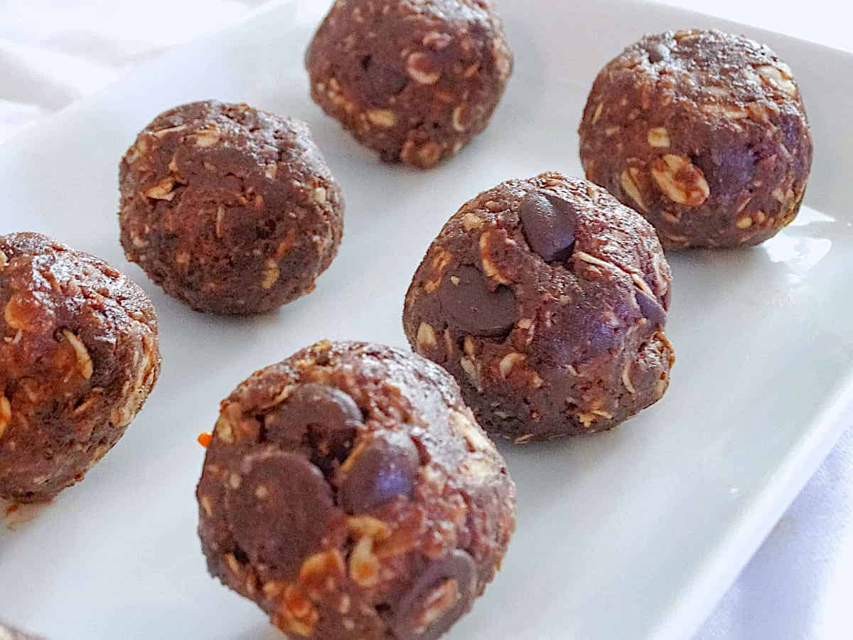 dark chocolate sea salt energy balls on a white plate
