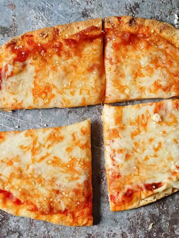 cheesy flatbread pizza on a gray background