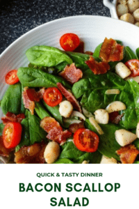 "alt=""scallop bacon salad with garlic butter sauce on a bed of spinach with tomatoes. pinterest link"""