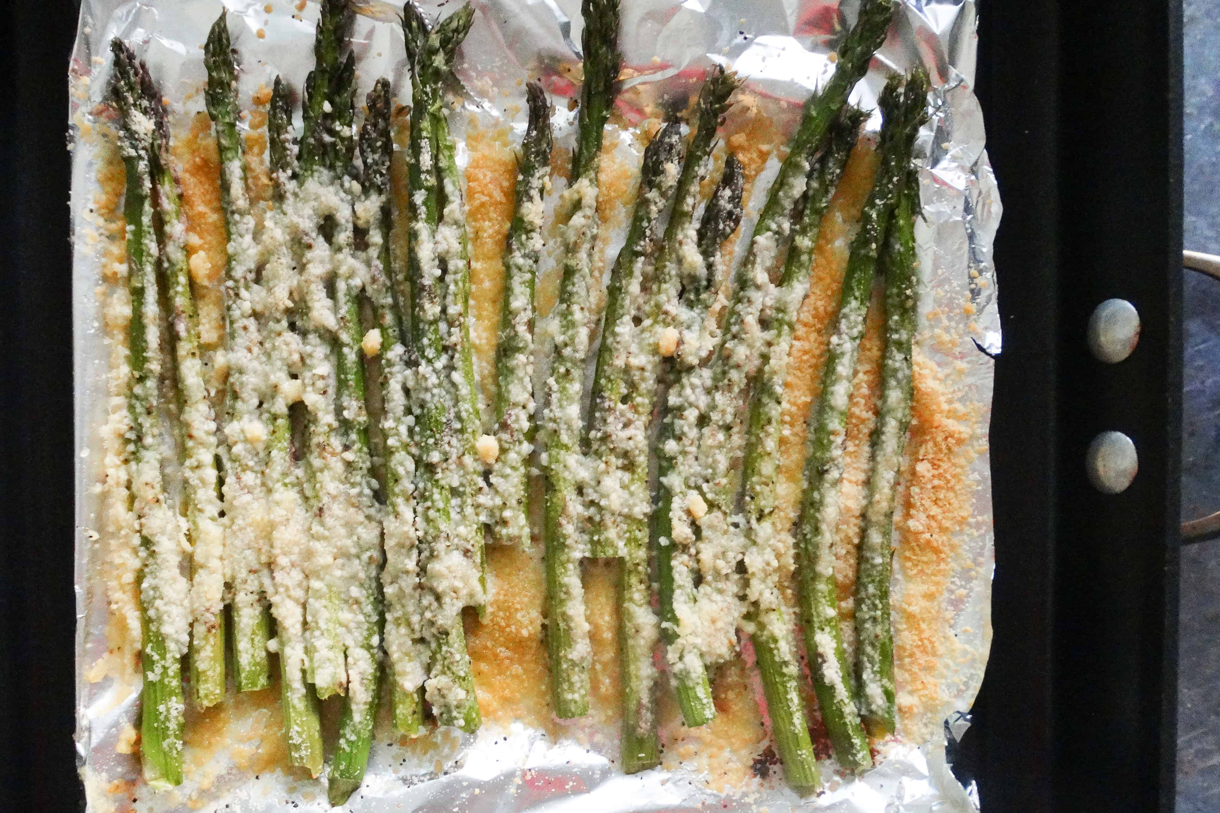 parmesan-roasted asparagus on foil lying on a frying pan