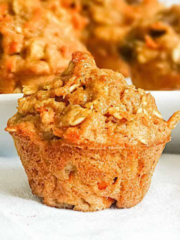 healthy carrot raisin muffin on a white cloth