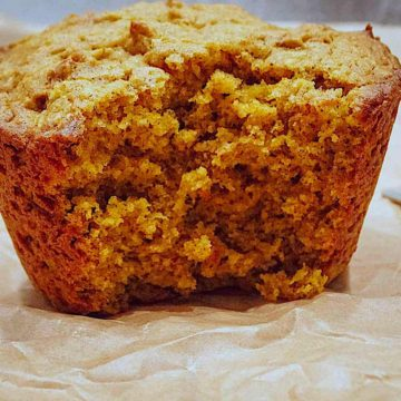 pumpkin spice muffin on brown parchment paper