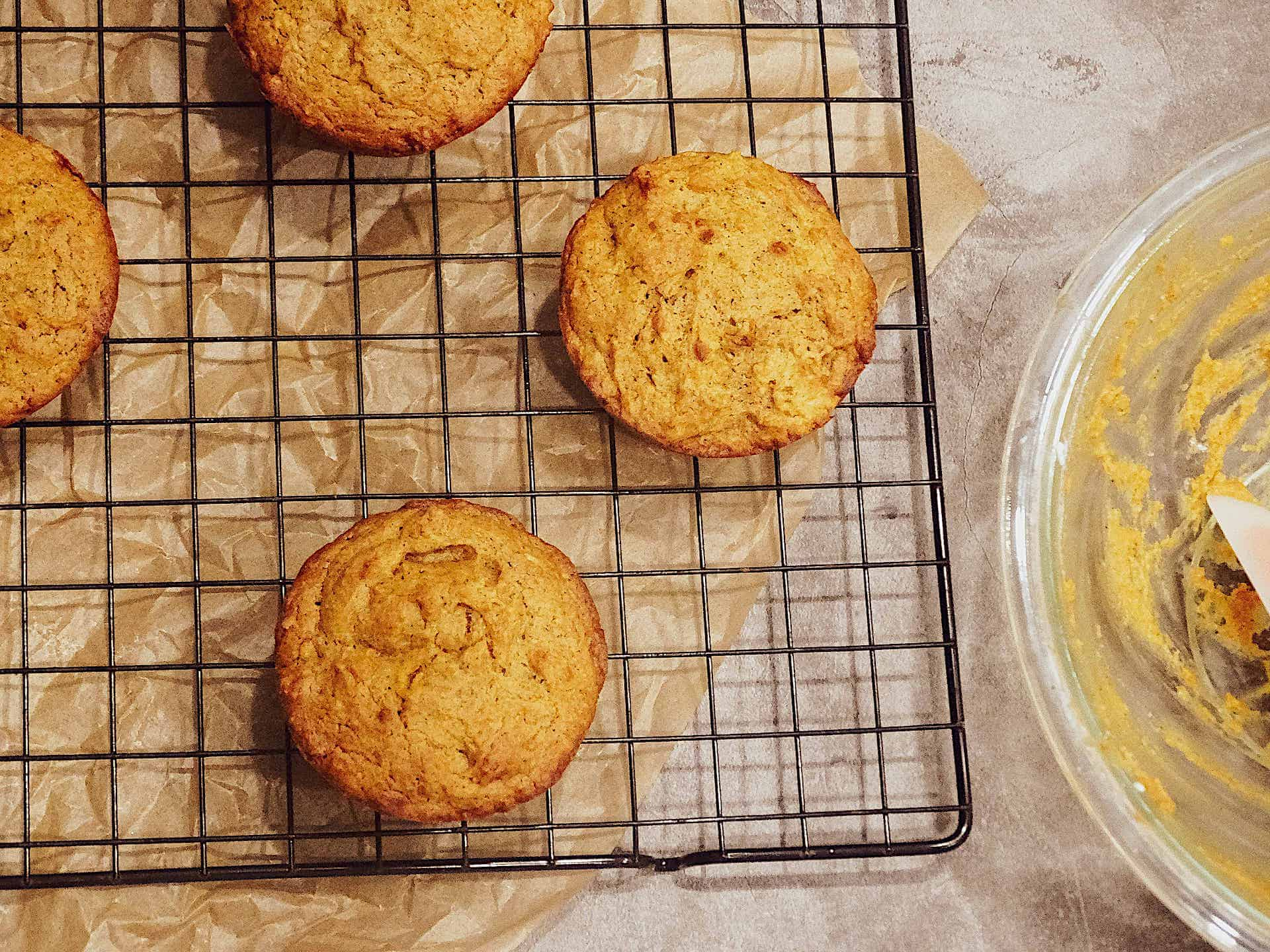 pumpkin spice muffins on a wire cooling rack