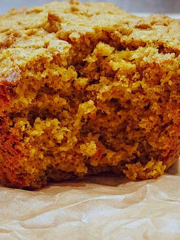 pumpkin spice muffin on parchment paper