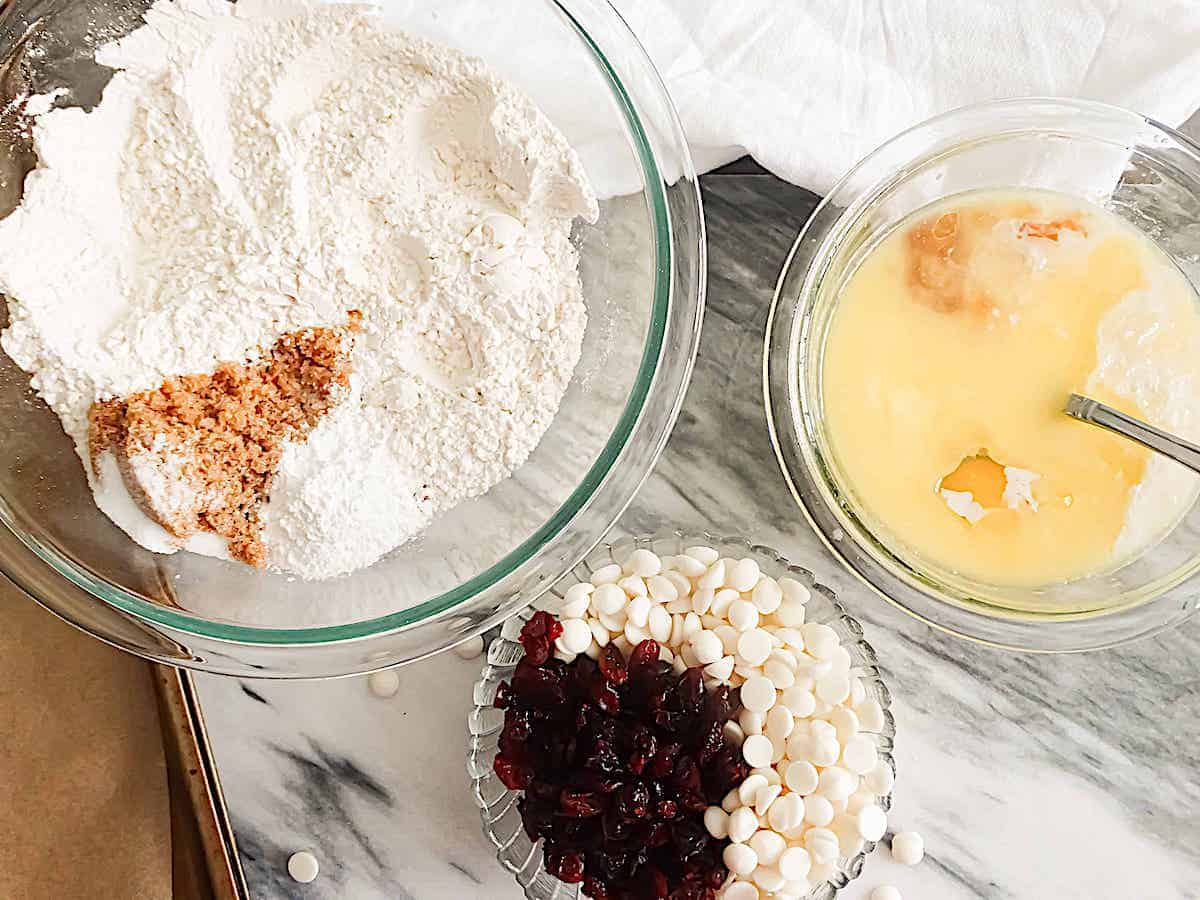 3 bowls of muffin ingredients: wet, dry, and mix ins