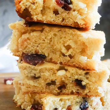 a stack of white chocolate cranberry muffin squares