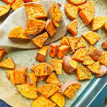 oregano roasted sweet potatoes on a baking sheet