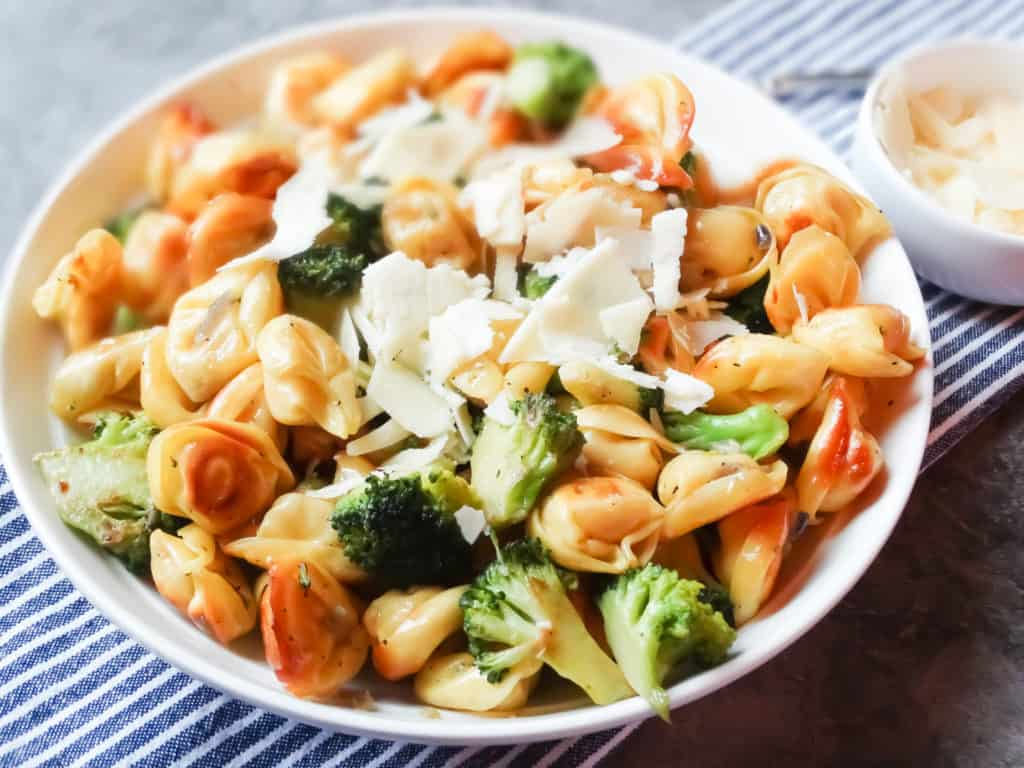 pan fried tortellini and broccoli in a white bowl