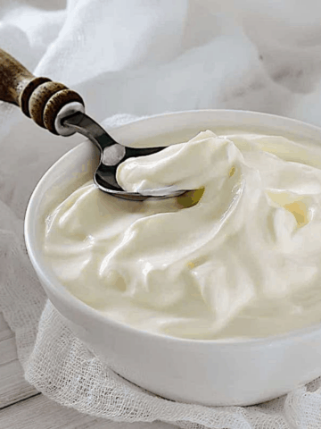 homemade greek yogurt in a white bowl