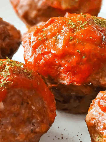 muffin tin meatloaf topped with tomato sauce
