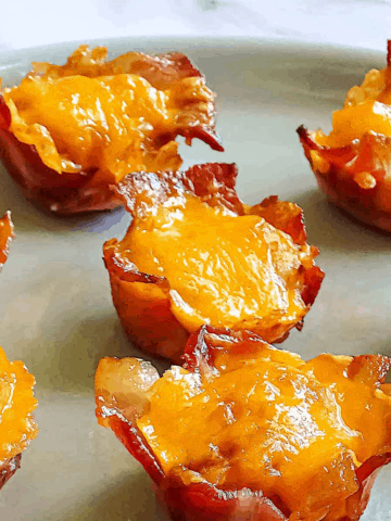 bacon tater tot cups on a gray plate