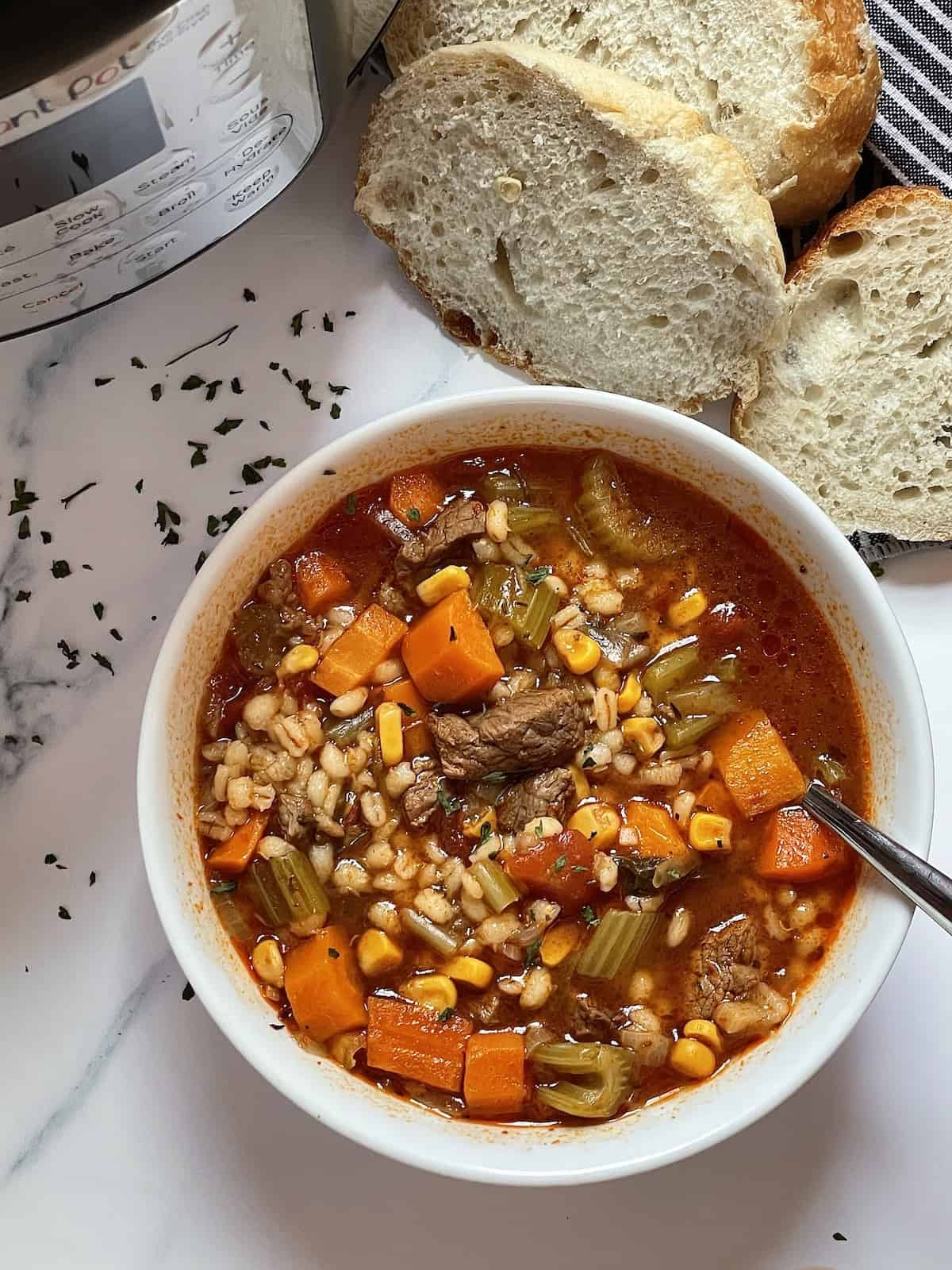 instant pot beef barley soup in a white bowl