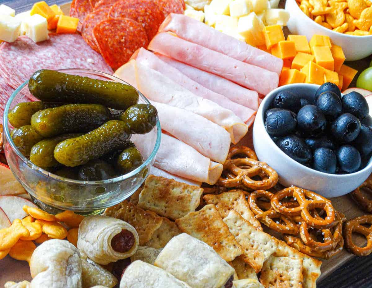 kid-friendly charcuterie board with fruits, vegetables, and breads