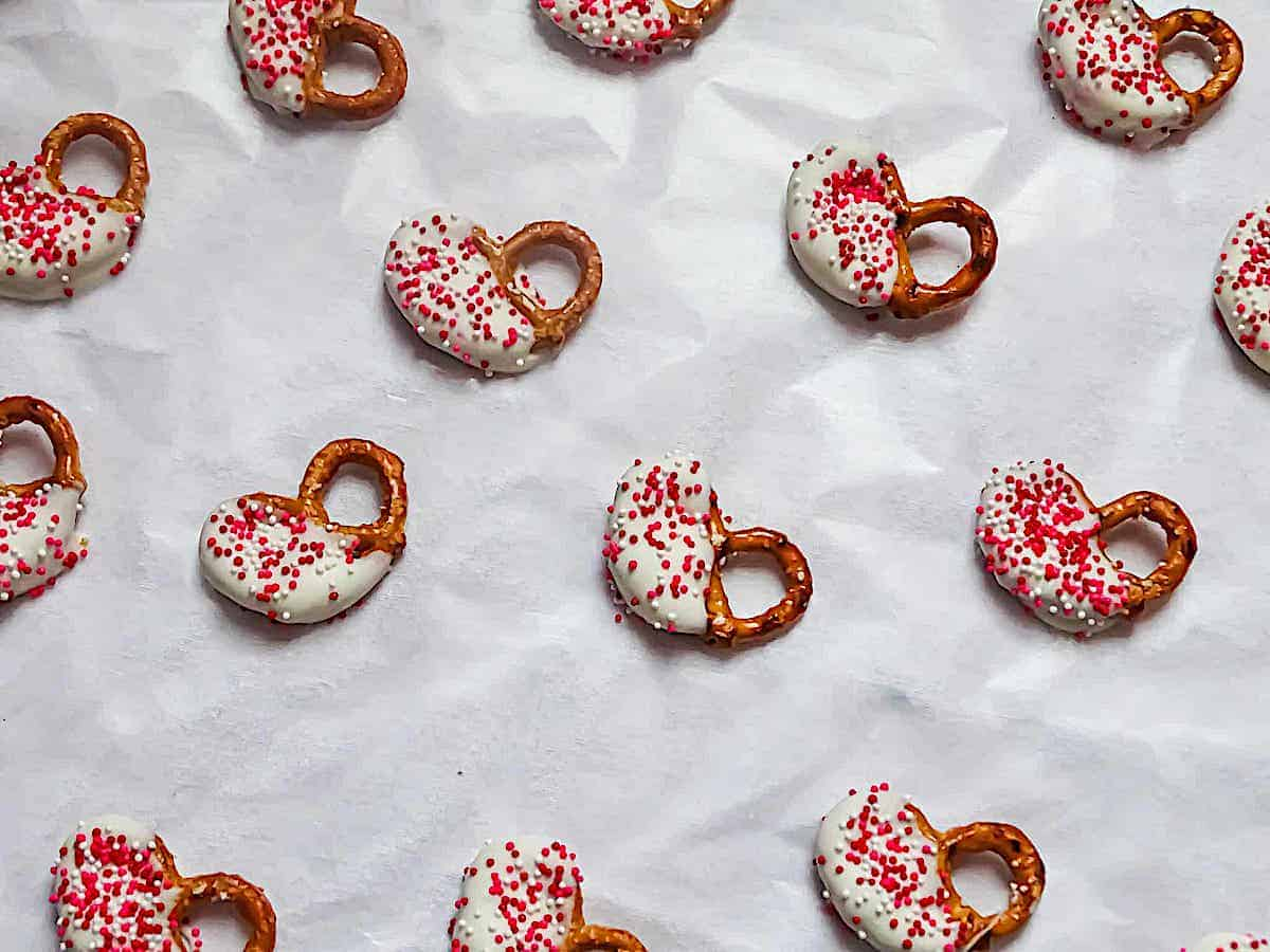 white chocolate covered pretzels on parchment paper