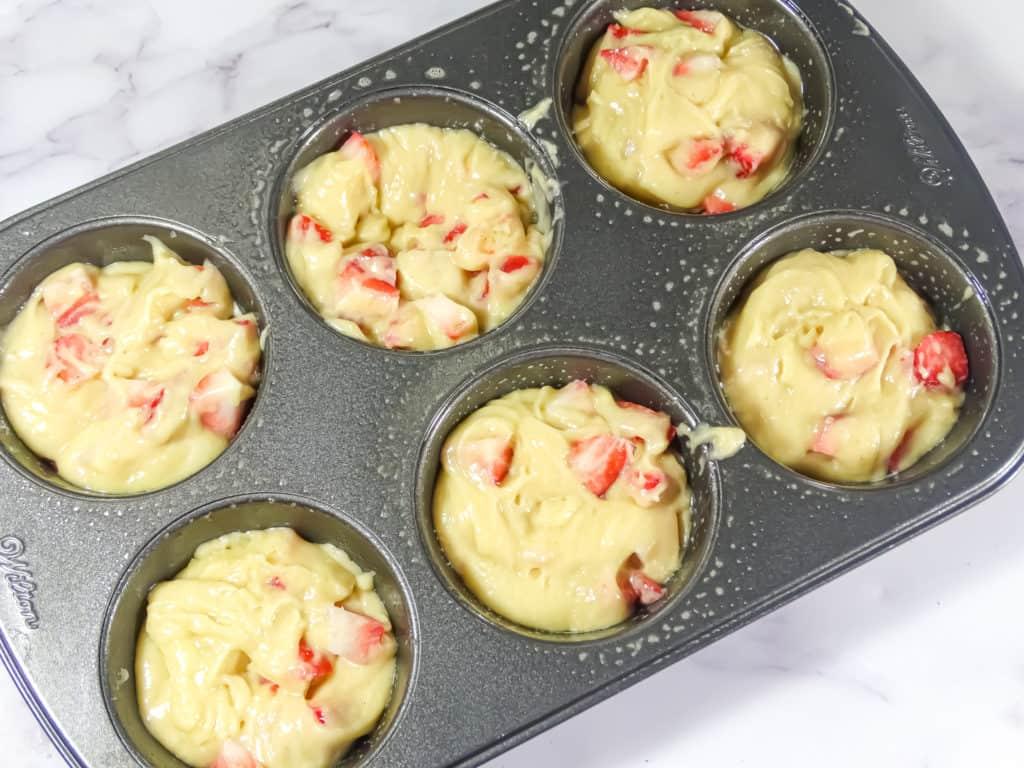 strawberry cheesecake muffin batter in jumbo muffin tin