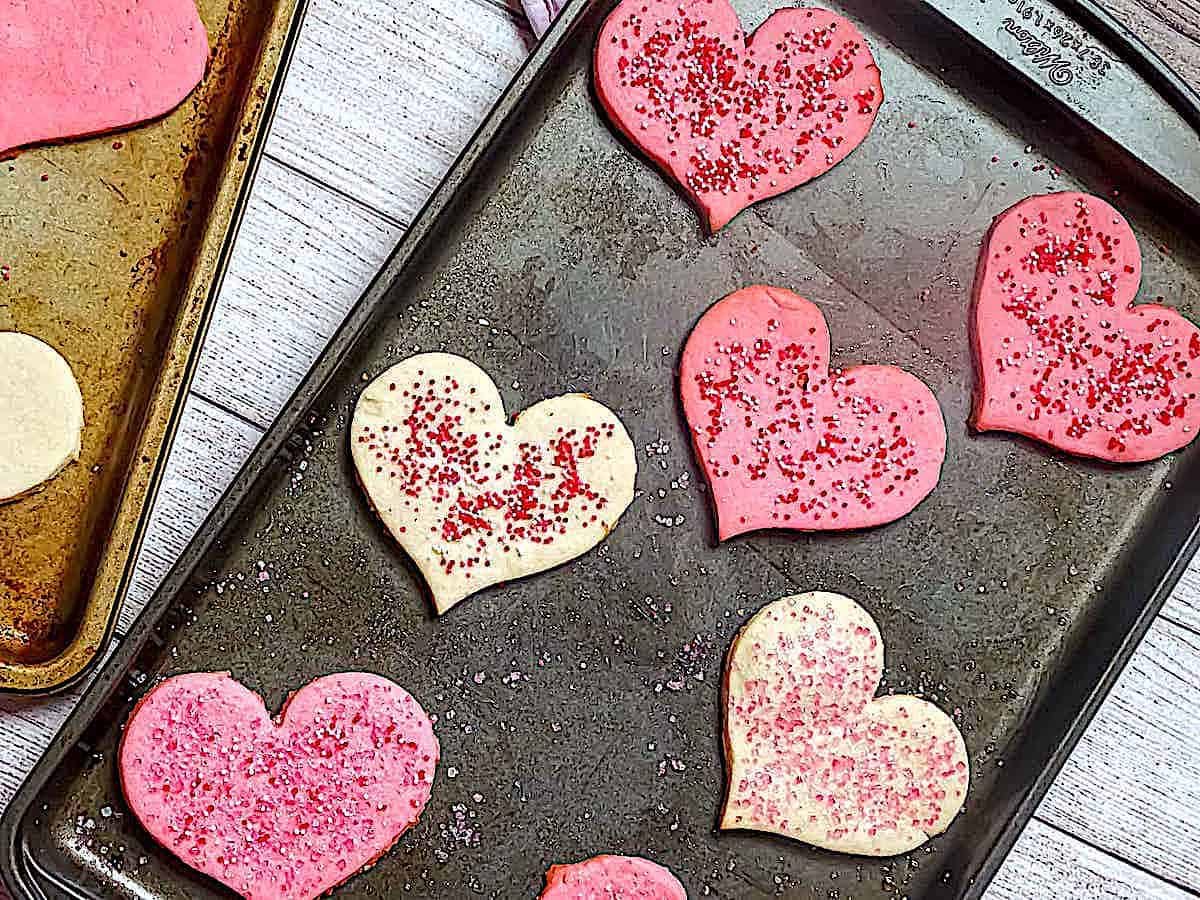 heart shaped butter cookies on a baking sheet