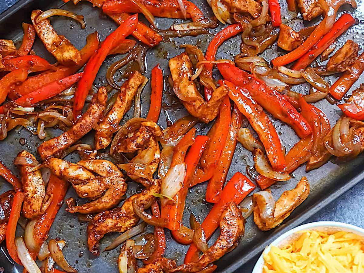 baked chicken fajitas on a sheet pan