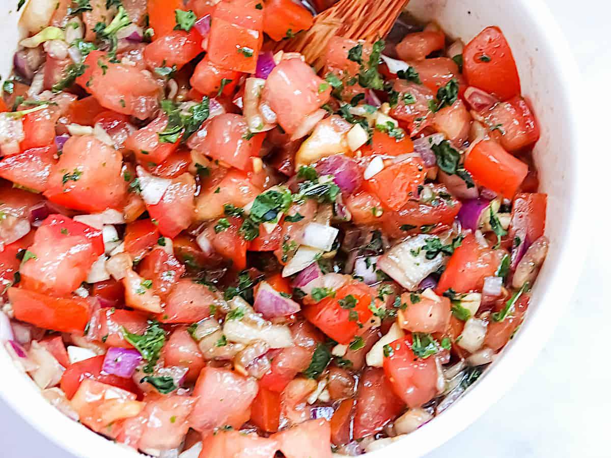 balsamic bruschetta in a white bowl