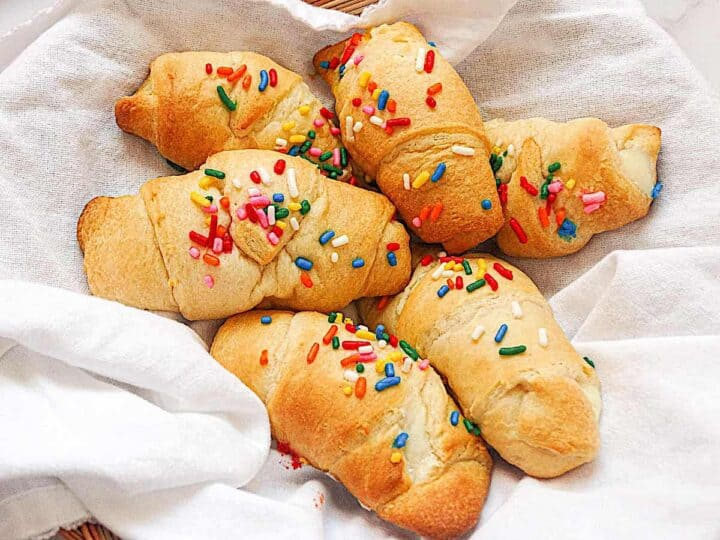 crescent rolls topped with rainbow sprinkles