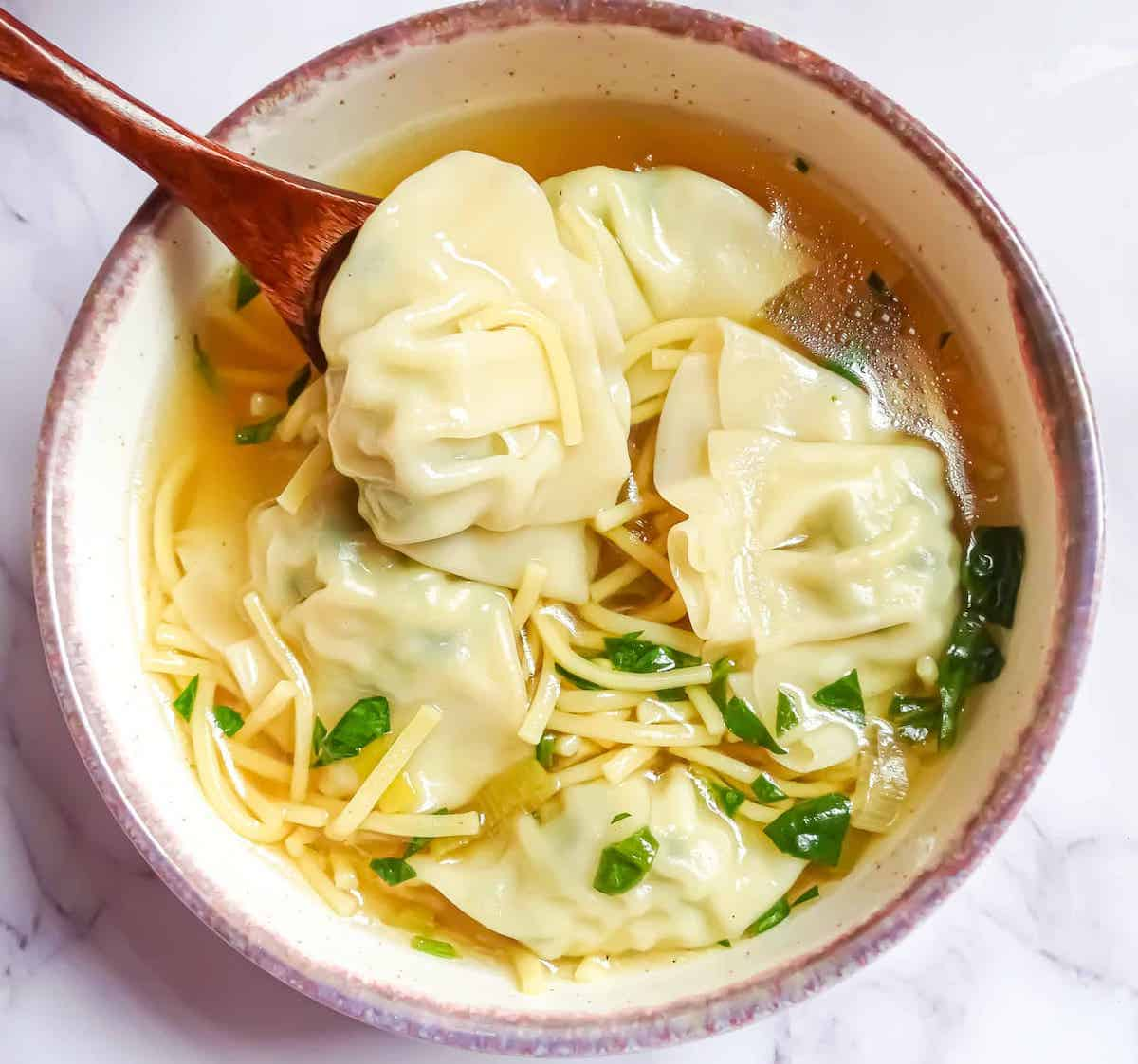 Instant pot wonton soup in a small bowl