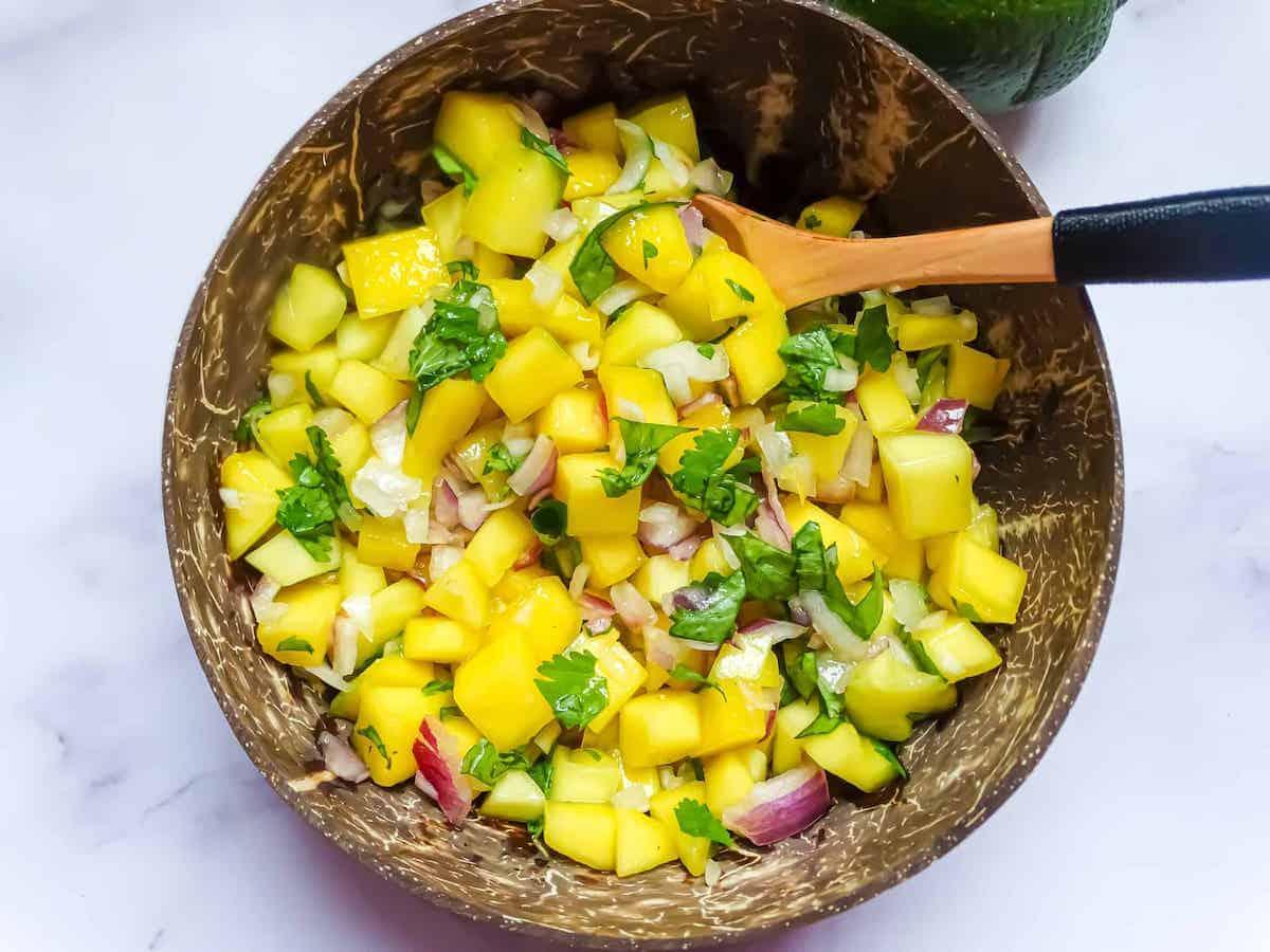 mango pico de gallo with a spoon in it