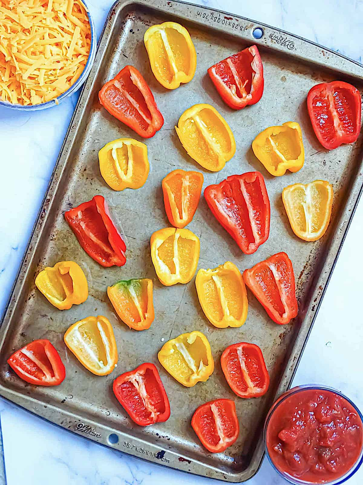 sliced peppers on a baking sheet