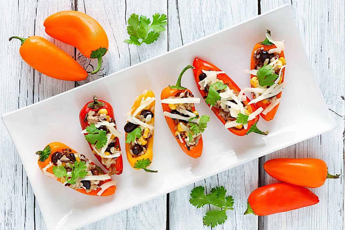 mini stuffed peppers on a white plate