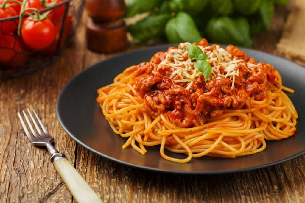 spaghetti with homemade tomato sauce on a serving plate