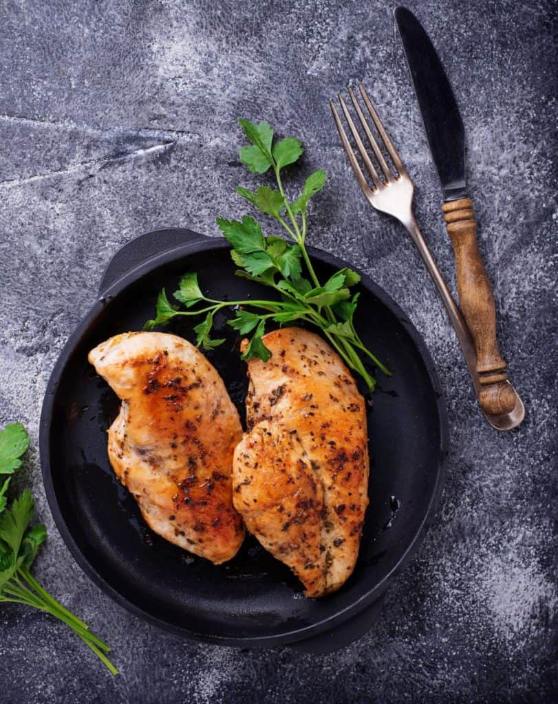 pan seared herb chicken on a grey plate