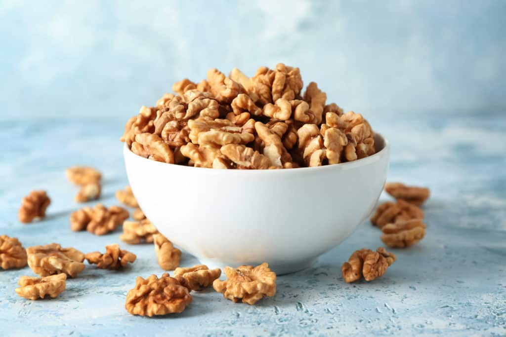 chopped walnuts in a white bowl