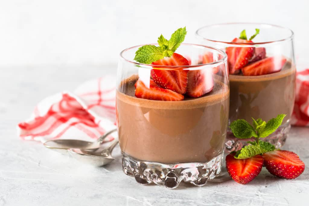 healthy chocolate pudding with strawberries in a glass jar