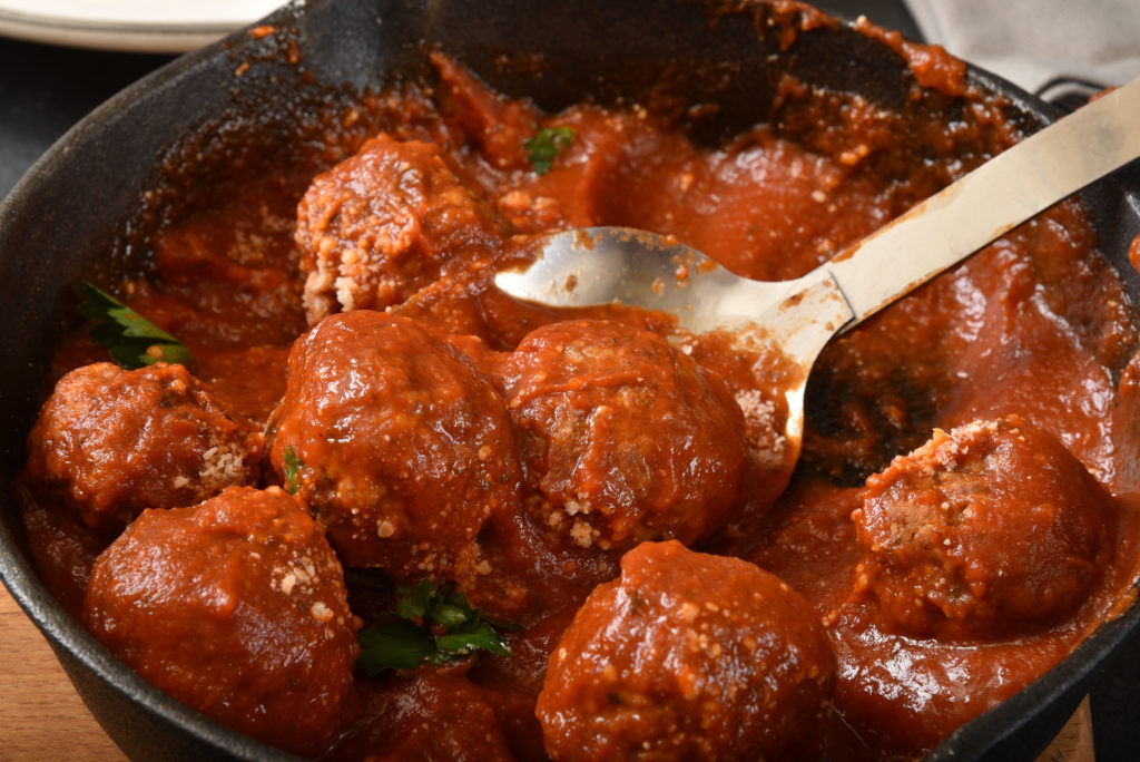 meatballs in homemade tomato sauce in a pot