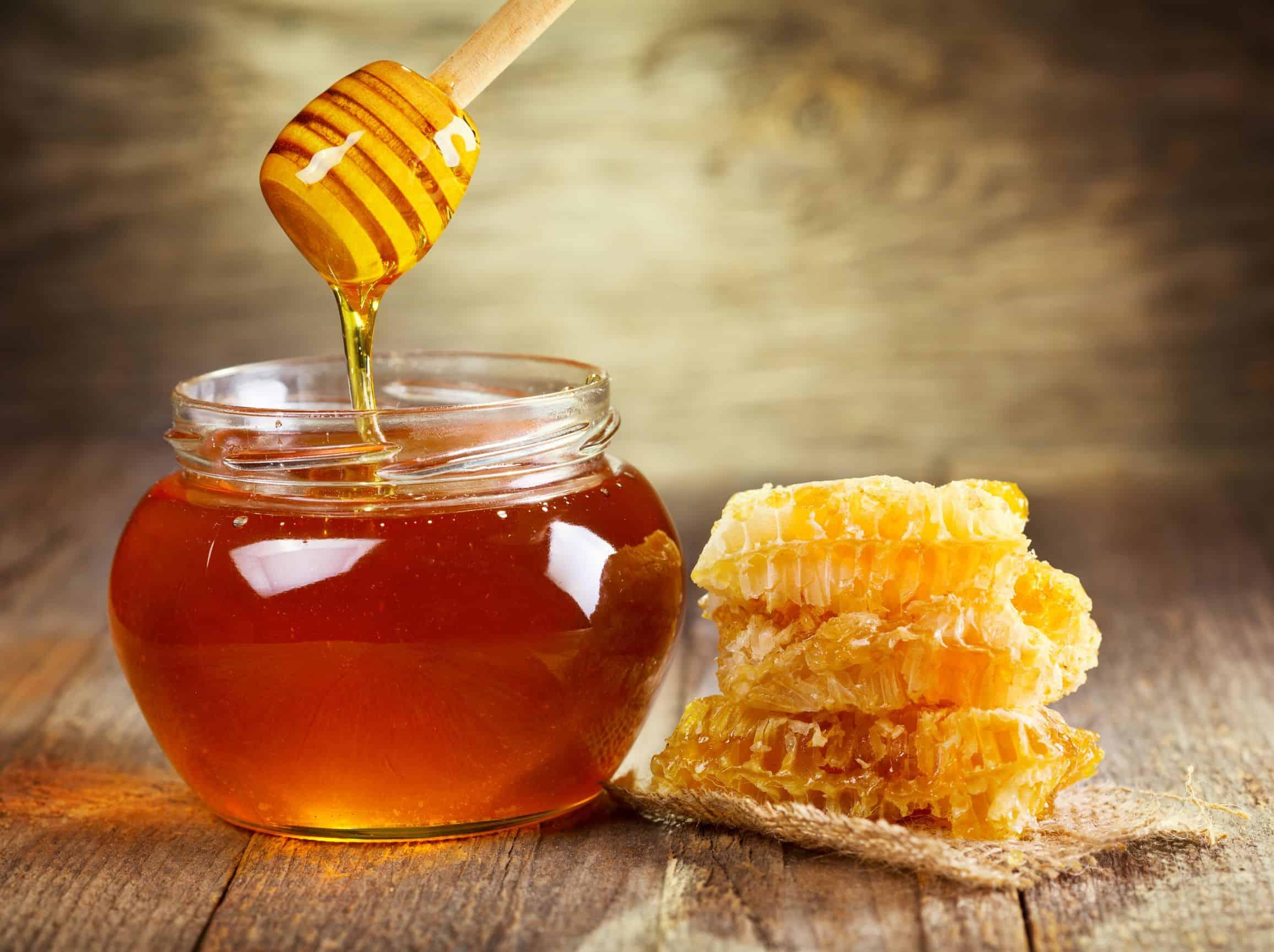 honey being poured off a honey stick