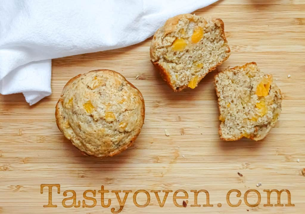 peach muffins made with flax eggs on a cutting board