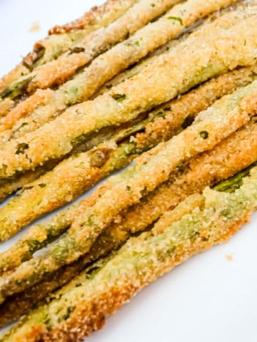 pan fried asparagus on a white plate