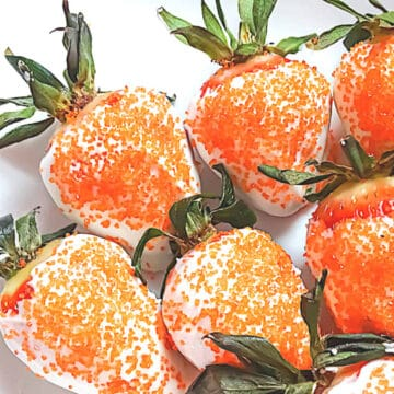 Easter dessert - chocolate covered strawberries with orange sprinkles