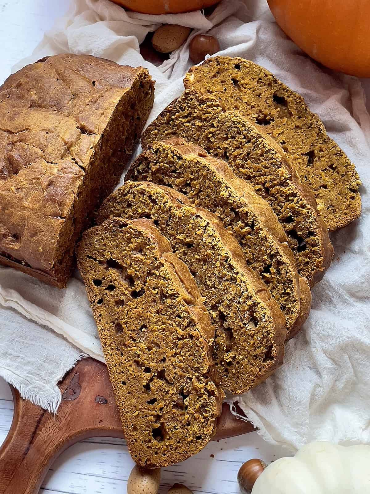 close up of pumpkin bread on a wooden cutting board