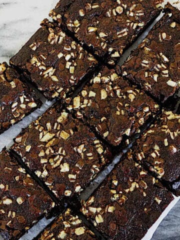 mint chocolate brownies sliced on parchment paper
