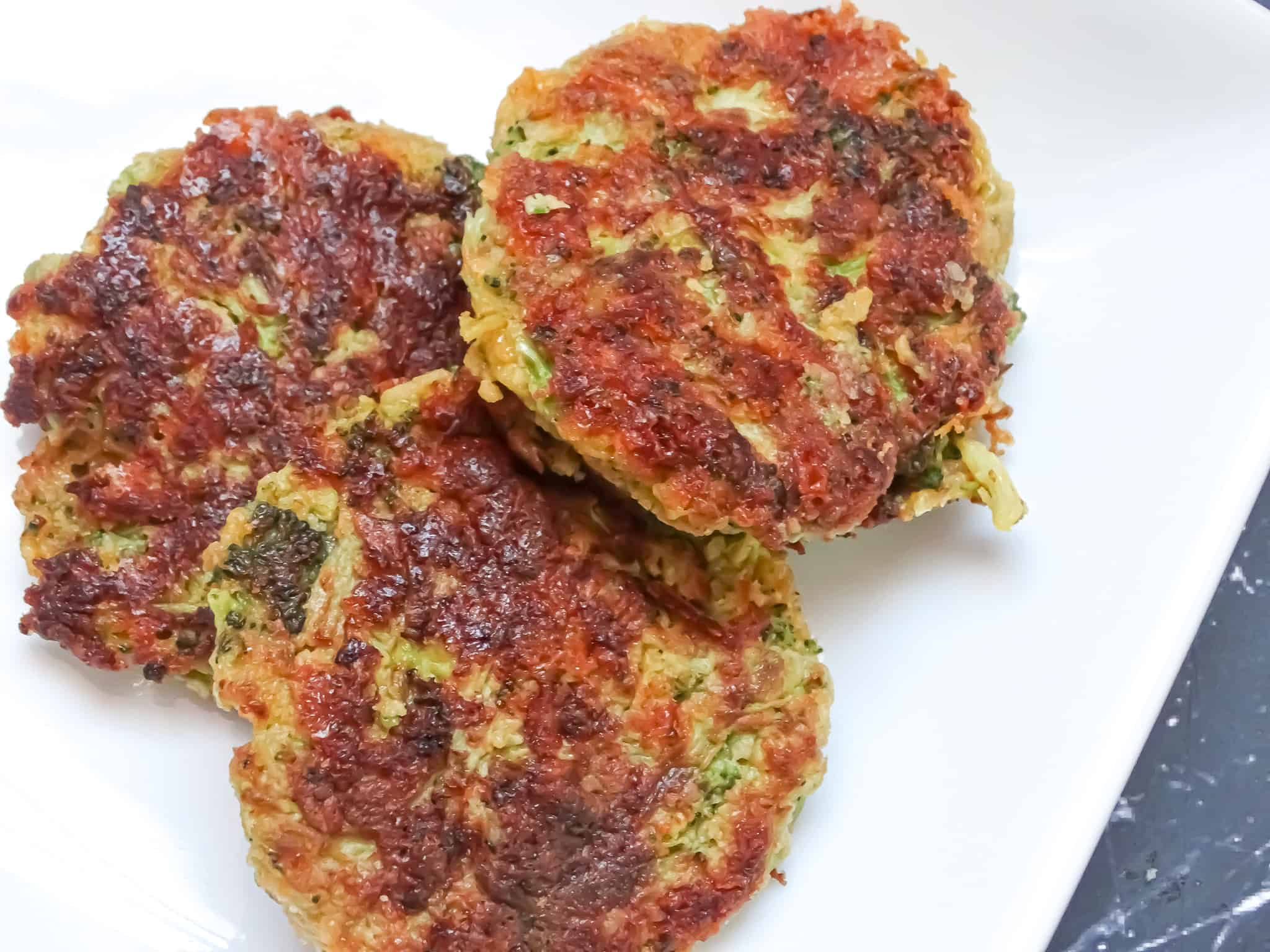 broccoli cheddar fritters on a white plate