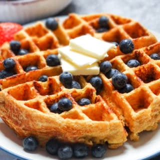 cottage cheese waffles topped with blueberries and butter