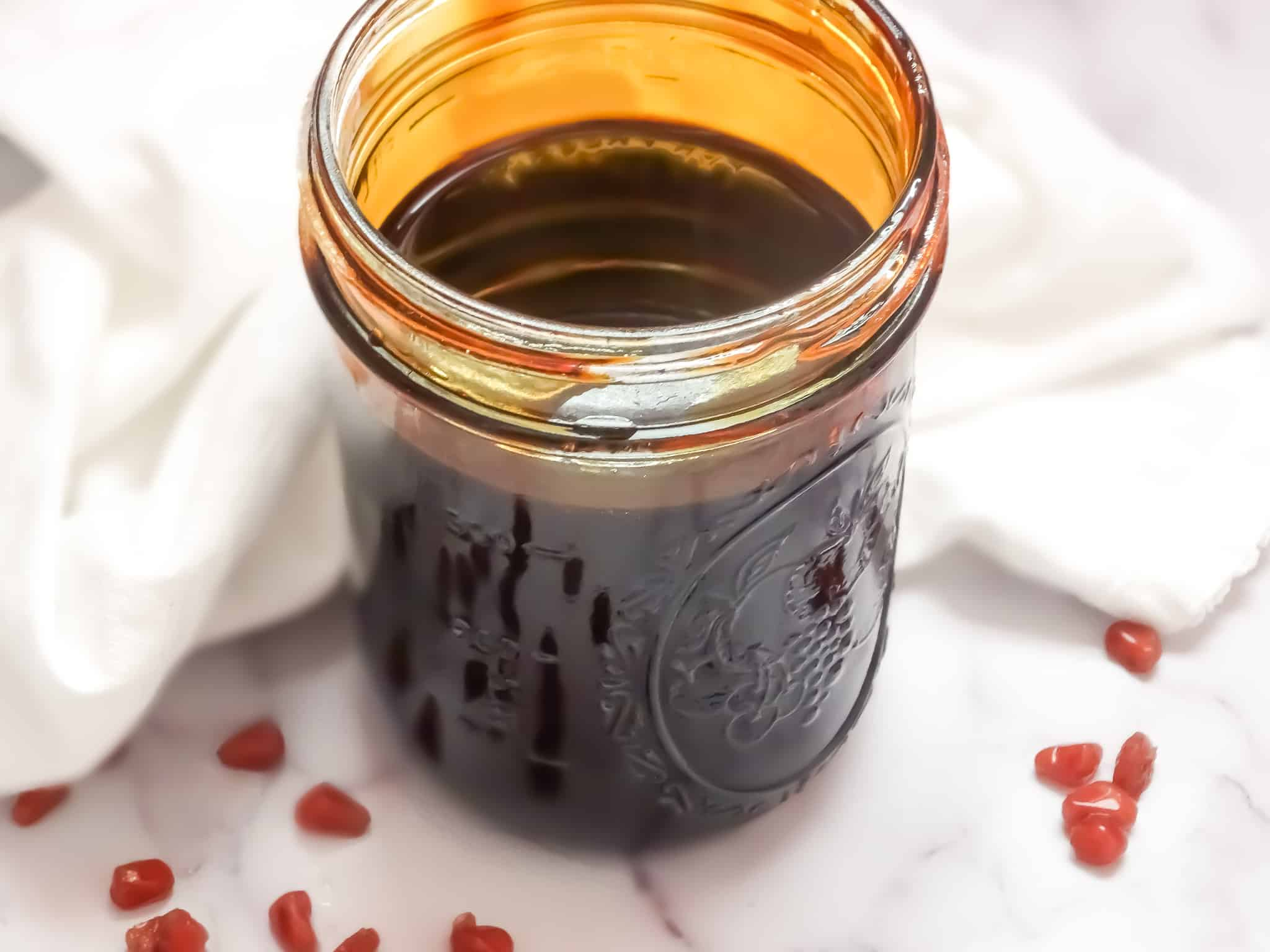 traditional middle eastern pomegranate syrup in a mason jar