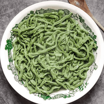 bread machine spinach pasta dough in a white bowl