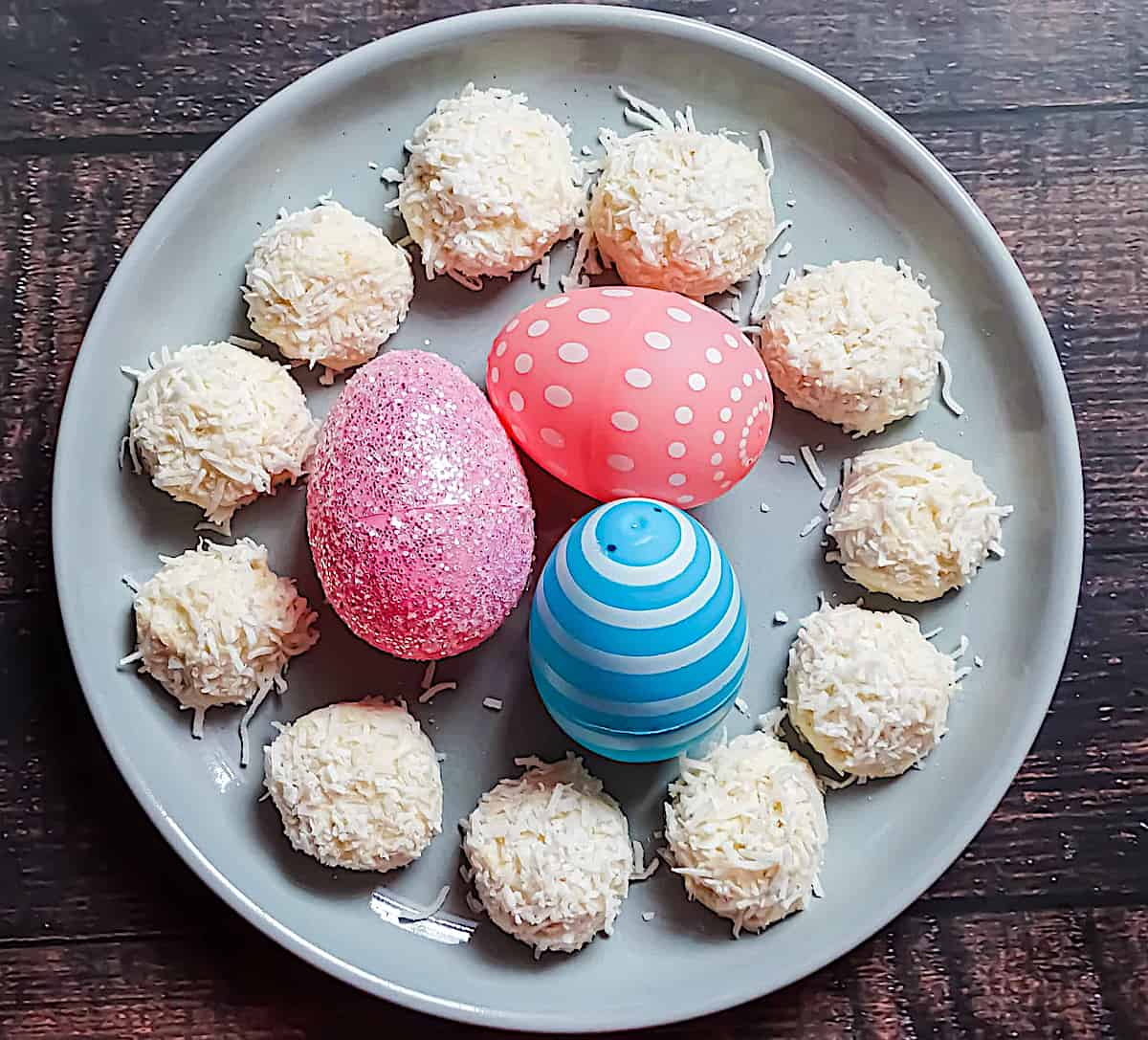 no bake cheesecake bites on a plate with Easter eggs