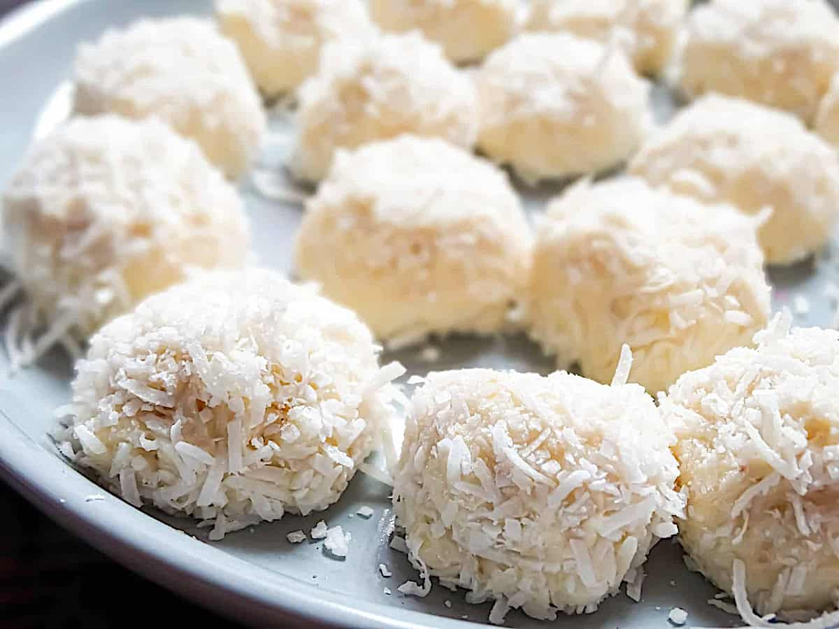 close up of coconut cheesecake bites on a plate