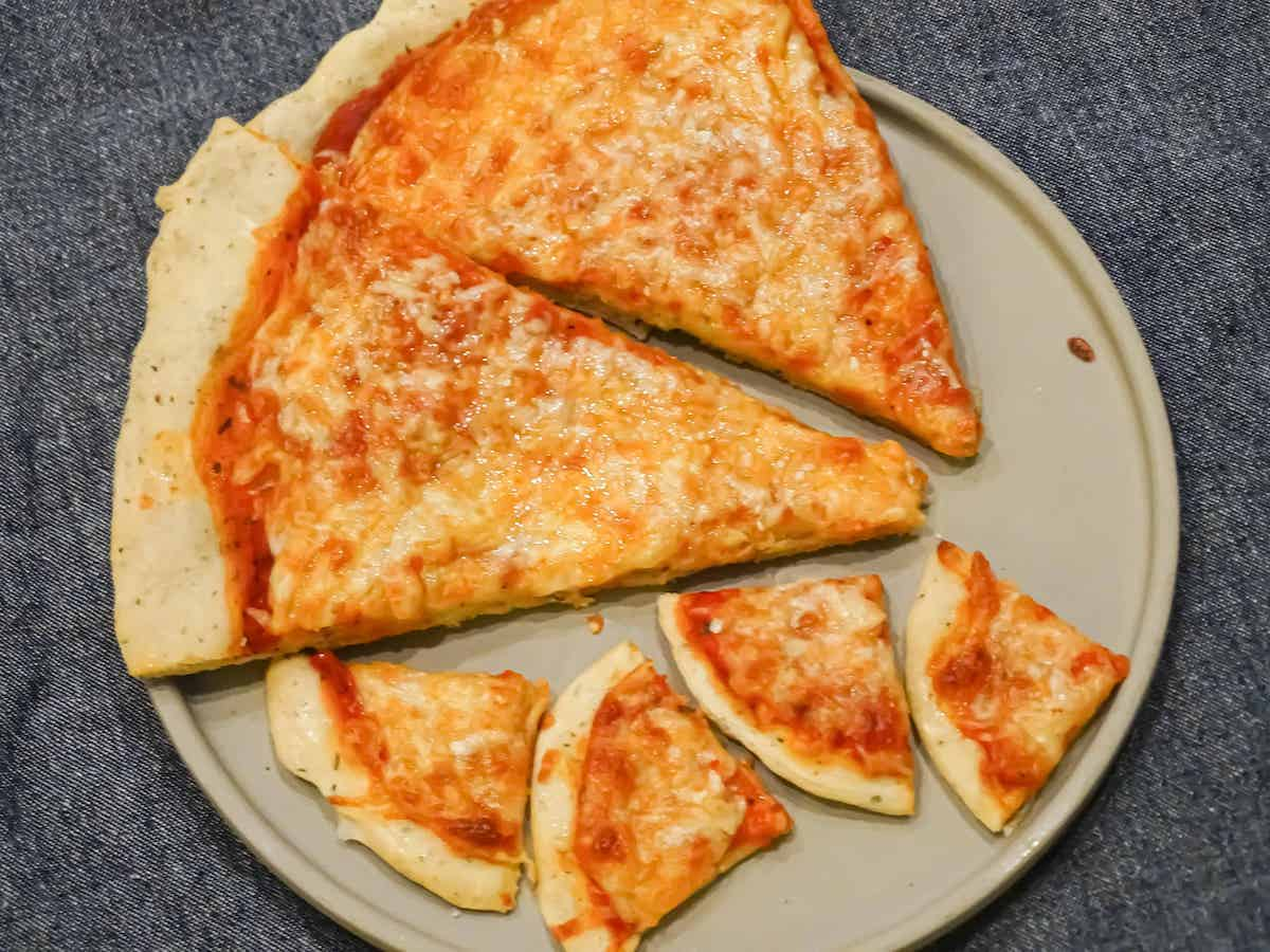 cooked cheese pizza sliced into small pieces
