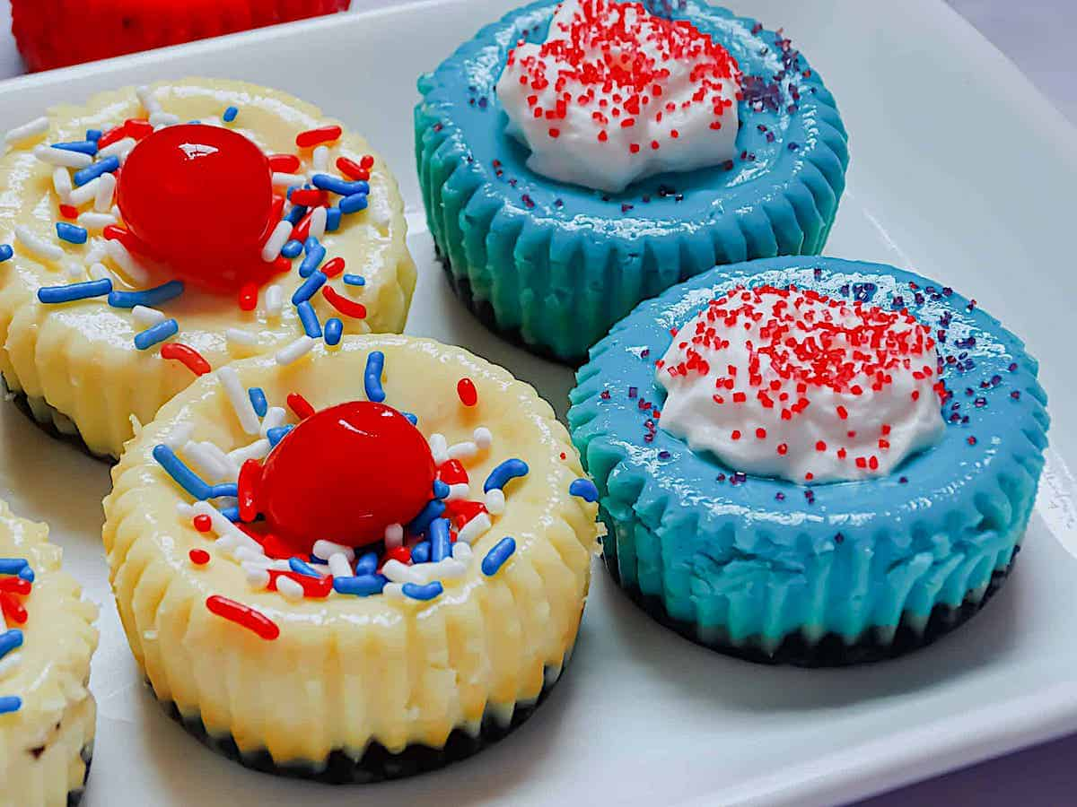close up of blue and white mini 4th of july cheesecakes