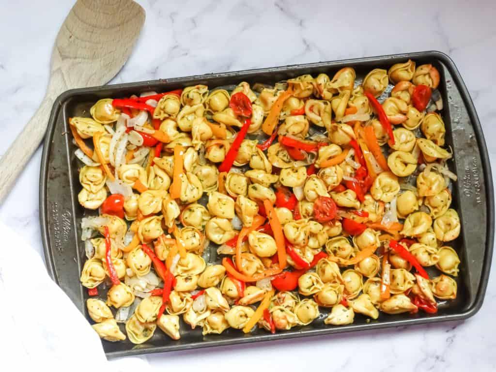 sheet pan roasted vegetable tortellini recipe on a baking sheet