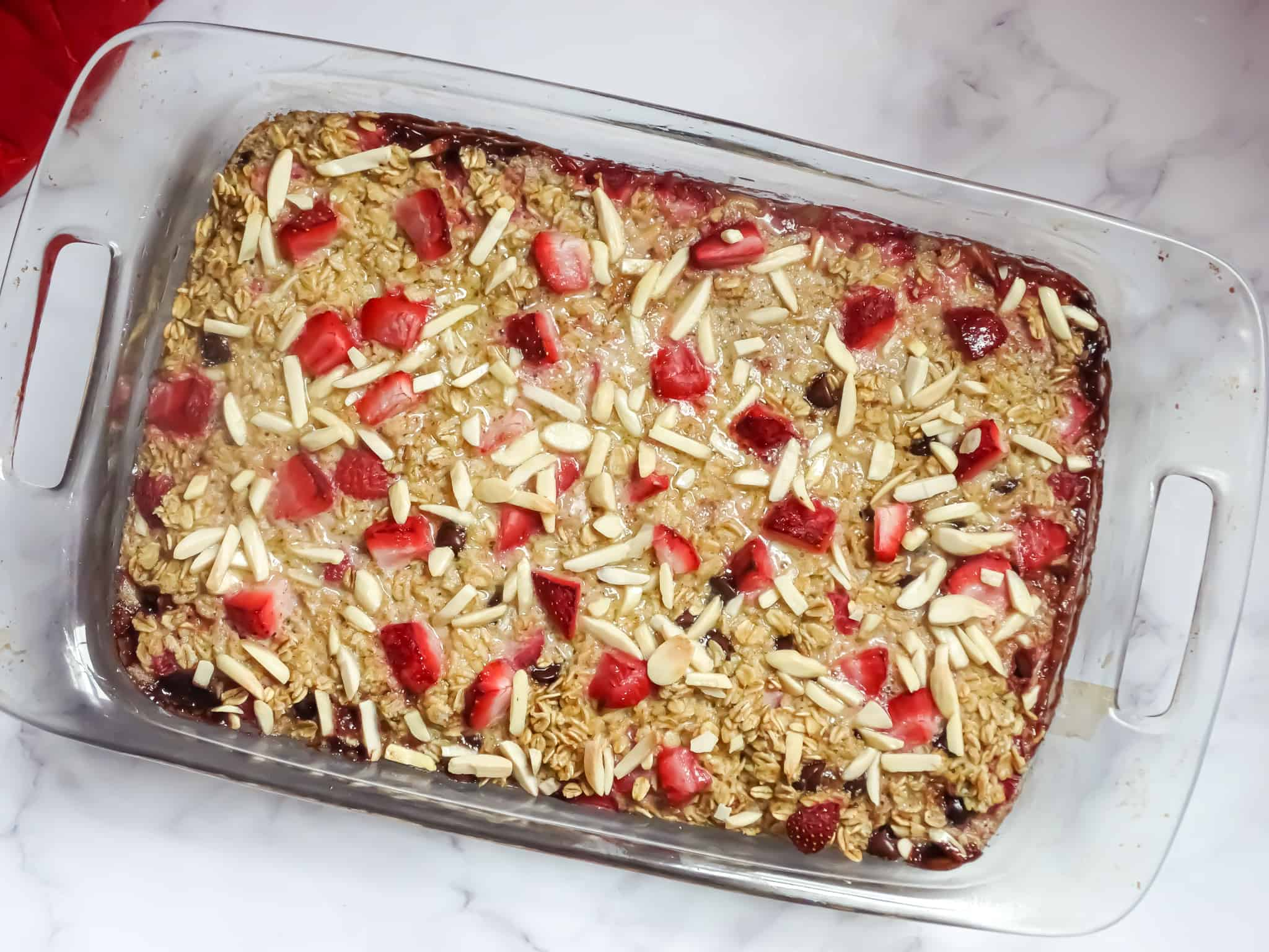 strawberry baked oatmeal recipe in a clear baking dish