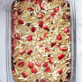 baked oatmeal topped with almonds and strawberries